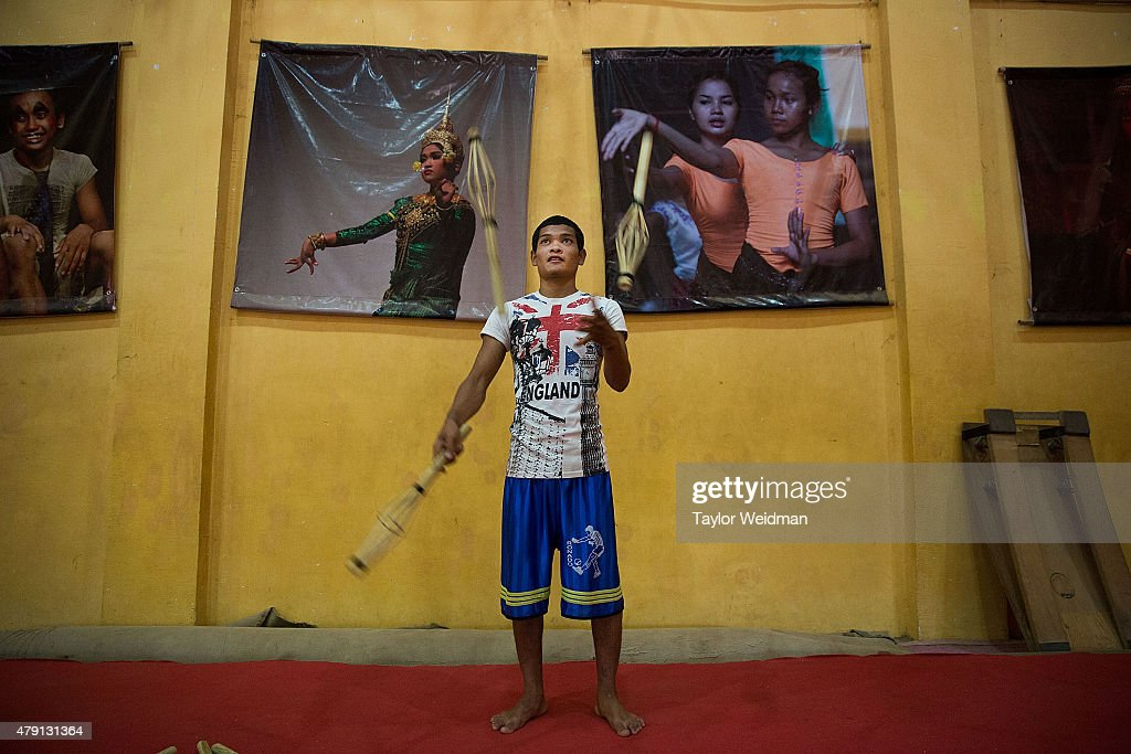 A circus student practices his juggling skills on July 1, 2015 at Phare Ponleu Salpak in Battambang, Cambodia. Phare Ponleu Salpak is an organization providing free education and artistic training to Cambodian children. Students in the organization's circus program often go on to careers performing both internationally and domestically at venues like Phare - The Cambodian Circus in Siem Reap.