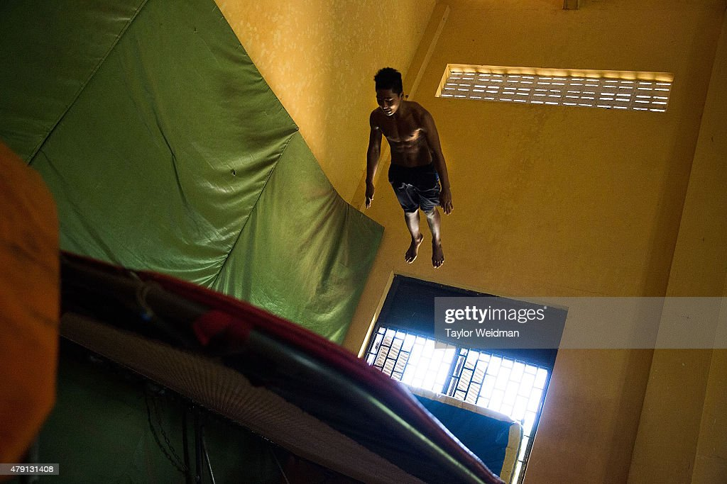 A circus student practices on a trampoline on July 1, 2015 at Phare Ponleu Salpak in Battambang, Cambodia. Phare Ponleu Salpak is an organization providing free education and artistic training to Cambodian children. Students in the organization's circus program often go on to careers performing both internationally and domestically at venues like Phare - The Cambodian Circus in Siem Reap.
