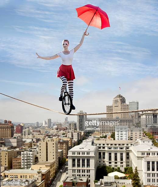 circus tightrope walker on a unicycle - circus stock pictures, royalty-free photos & images