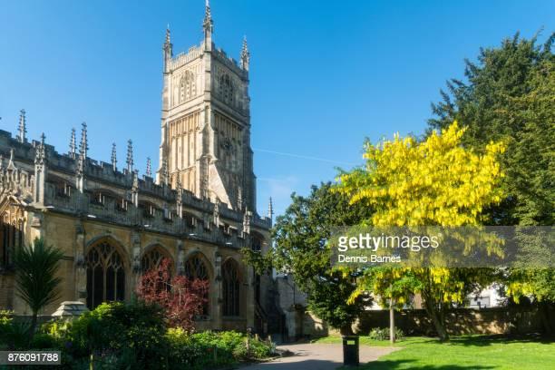 cirencester; parish church, st john baptist, cotswolds, laburnum flowering, uk - cirencester stock pictures, royalty-free photos & images