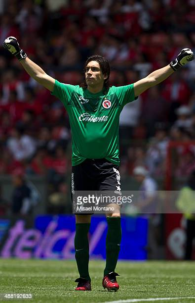 Cirilo Saucedo goalkeeper of Tijuana celebrates after the first scored goal against Toluca by his teammate Dario Bendetto during the Quarterfinal...