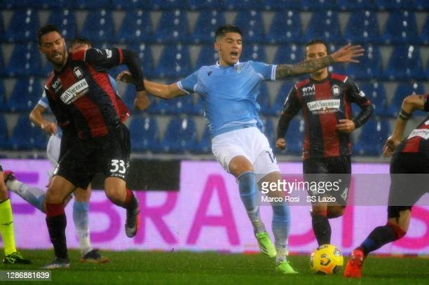 CirJoaquin Correa of SS Lazio competes for the ball with Marrone of FC Crotone during the Serie A match between FC Crotone and SS Lazio at Stadio...