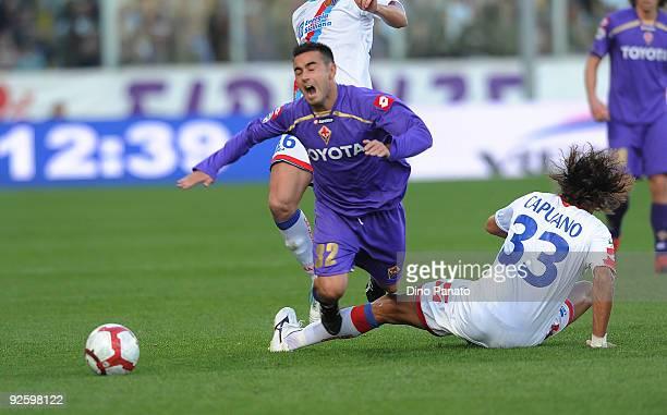 Ciro Capuano of Catania Calcio takles Marco Marchionni of ACF Fiorentina during the Serie A match between ACF Fiorentina and Catania Calcio at Stadio...