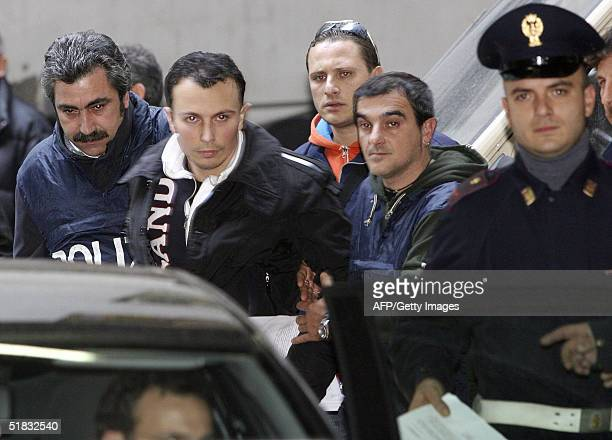 Ciro Di Lauro is arrested by Italian policemen during a huge ongoing operation involving hundreds of police officers, early 07 December 2004 in...