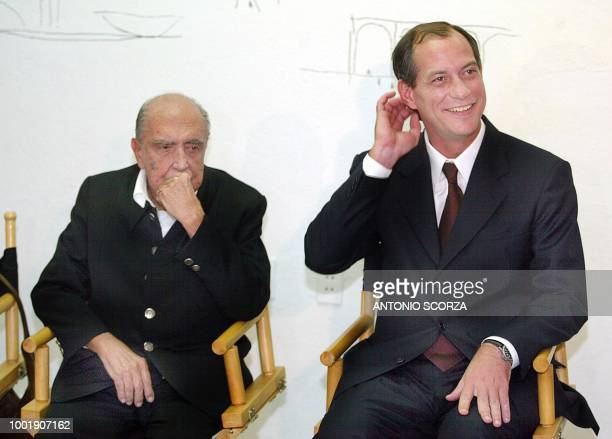 Ciro Gomes Brazilian presidential candidate for the Social Progressive Party accompanied with architect Oscar Niemeyer receives questions at a...