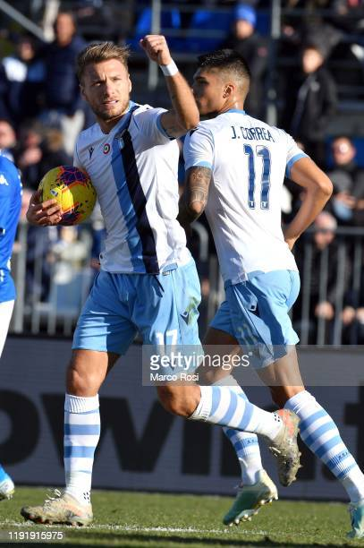 Ciro Immobil of SS Lazio celebrate a frist a penalty with his team mates during the Serie A match between Brescia Calcio and SS Lazio at Stadio Mario...