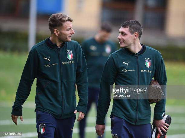 Ciro Immobile and Andrea Belotti of Italy chat during Italy training session at Centro Tecnico Federale di Coverciano on November 12, 2019 in...