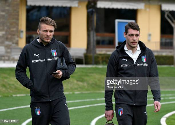 Ciro Immobile and Andrea Belotti of Italy chat prior to the Italy training session at Centro Tecnico Federale di Coverciano on March 20 2018 in...