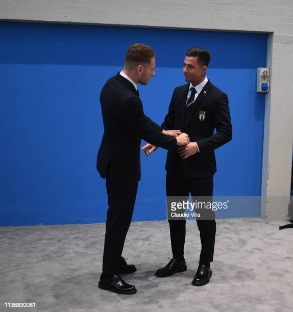 Ciro Immobile and Armando Izzo attend of the Italy team photo with the new Armani suit at Centro Tecnico Federale di Coverciano on March 19 2019 in...