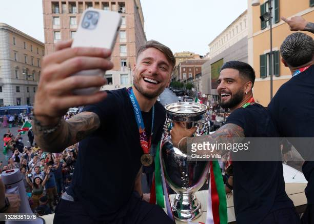 Ciro Immobile and Lorenzo Insigne of Italy celebrate during Italy's national men's football team open-top bus victory parade, a day after Italy won...