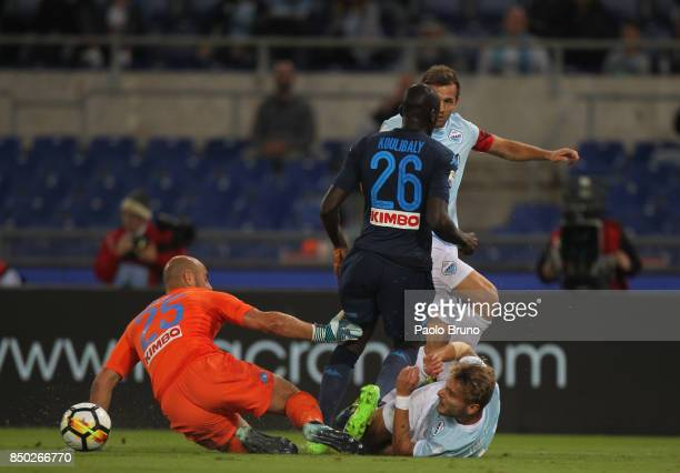 Ciro Immobile and Senad Lulic of SS Lazio compete for the ball with Kalidou Koulibaly and Jose' Reina of SSC Napoli during the Serie A match between...