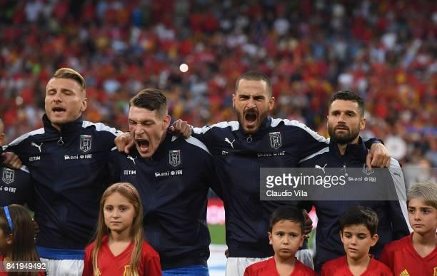 Ciro Immobile Andrea Belotti Leonardo Bonucci and Antonio Candreva of Italy sing the Italy's national anthem prior to the FIFA during the FIFA 2018...