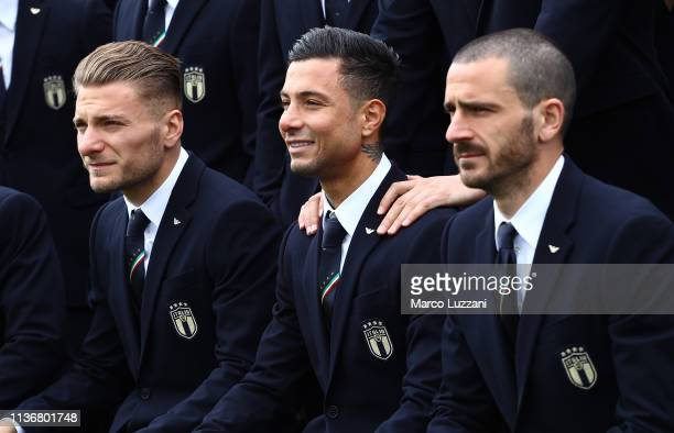 Ciro Immobile Armando Izzo and Leonardo Bonucci are seen during Italy team photo with the new Armani suit at Centro Tecnico Federale di Coverciano on...
