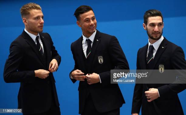 Ciro Immobile Armando Izzo and Matteo Politano look on ahead of the Italy team photo with the new Armani suit at Centro Tecnico Federale di...