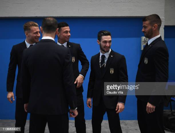 Ciro Immobile Armando Izzo Matteo Politano and Leonardo Spinazzola pose ahead of the Italy team photo with the new Armani suit at Centro Tecnico...
