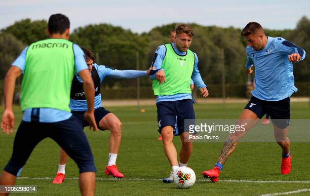 Ciro Immobile competes for the ball with Sergej Milinkovic Savic of SS Lazio during the SS Lazio training session at Formello sport centre on March 5...