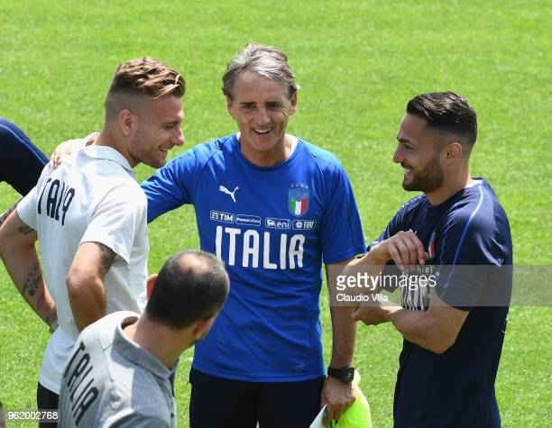 Ciro Immobile head coach Italy Roberto Mancini and Danilo D'Ambrosio chat during a Italy training session at Centro Tecnico Federale di Coverciano on...