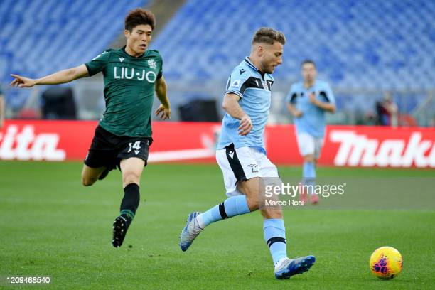 Ciro Immobile o of SS Lazio compete for the ball with Takehiro Tomiyasu during the Serie A match between SS Lazio and Bologna FC at Stadio Olimpico...