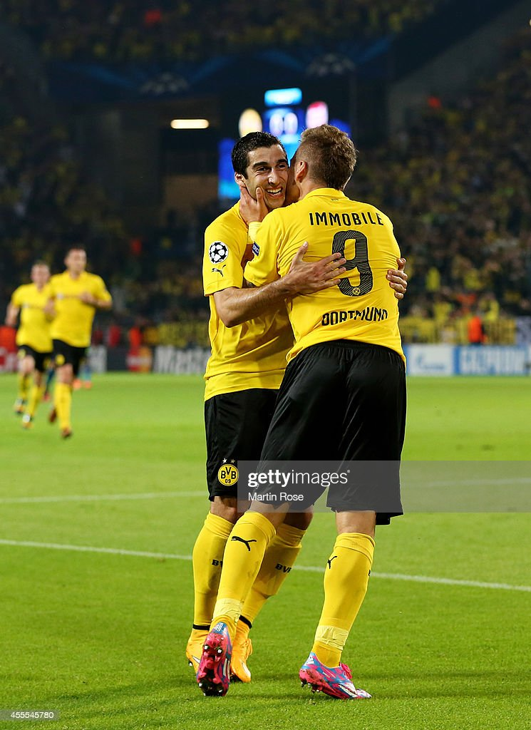 Ciro Immobile #9 of Borussia Dortmund is congratulated by teammate Henrikh Mkhitaryan (L) of Borussia Dortmund after scoring the opening goal on the stroke of half time during the UEFA Champions League Group D match between Borussia Dortmund and Arsenal at Signal Iduna Park on September 16, 2014 in Dortmund, Germany.