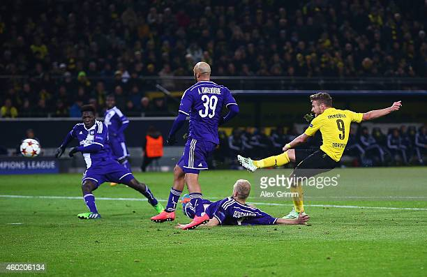 Ciro Immobile of Borussia Dortmund scores the opening goal during the UEFA Champions League Group D match between Borussia Dortmund and RSC...