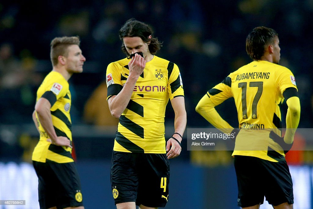 Ciro Immobile of Dortmund reacts with his team mates Neven Subotic and Pierre-Emerick Aubameyang after the Bundesliga match between Borussia Dortmund and FC Augsburg at Signal Iduna Park on February 4, 2015 in Dortmund, Germany.