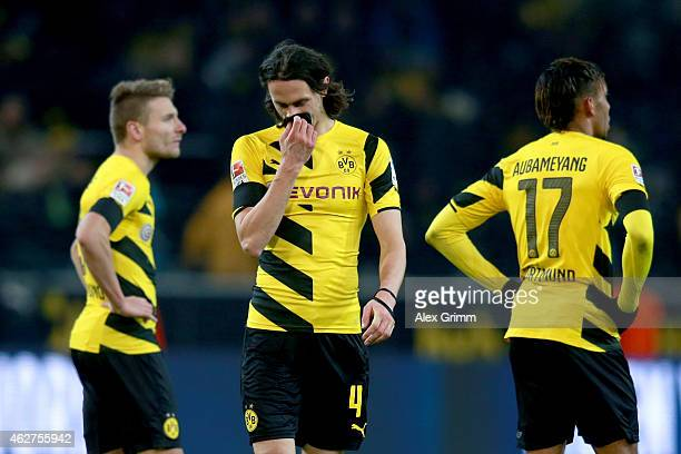 Ciro Immobile of Dortmund reacts with his team mates Neven Subotic and PierreEmerick Aubameyang after the Bundesliga match between Borussia Dortmund...