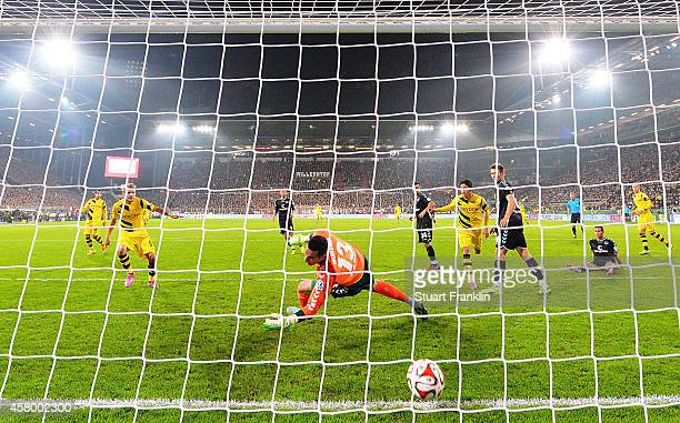 Ciro Immobile of Dortmund scores the first goal during the DFB Cup match between FC St Pauli and Borussia Dortmund at Millerntor Stadium on October...