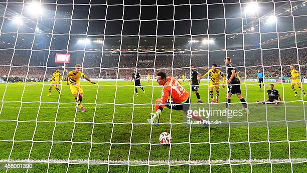 Ciro Immobile of Dortmund scores the first goal during the the DFB Cup match between FC St Pauli and Borussia Dortmund at Millerntor Stadium on...