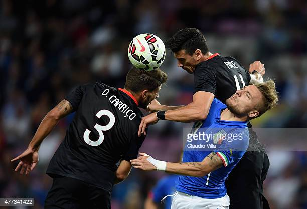 Ciro Immobile of Italy and Daniel Carrico of Portugal compete for the ball during the international friendly match between Portugal and Italy at...