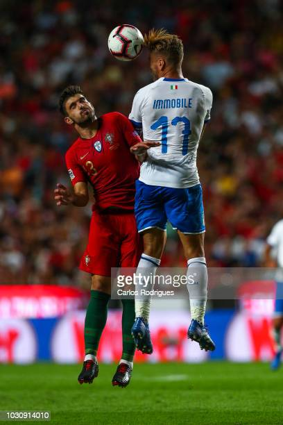 Ciro Immobile of Italy and SS Lazio higher that Ruben Neves of Portugal and Wolverhampton heads the ball away during the UEFA Nations League A group...