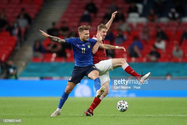 Ciro Immobile of Italy battles for possession with Martin Hinteregger of Austria during the UEFA Euro 2020 Championship Round of 16 match between...