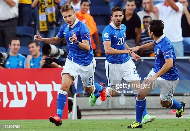 Ciro Immobile of Italy celebrates his team's first goal with team mates Fabio Borini and Giulio Donati during the UEFA European U21 Championship...