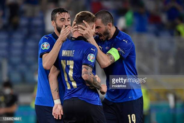Ciro Immobile of Italy celebrates with Bryan Cristante and Leonardo Bonucci after scoring the goal of 3-0 during the Uefa Euro 2020 Group A football...