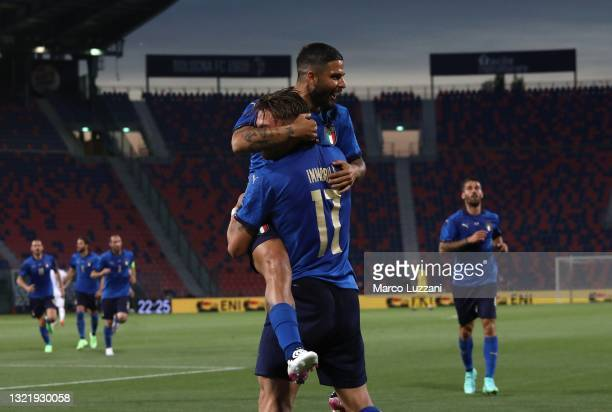 Ciro Immobile of Italy celebrates with his team-mate Lorenzo Insigne after scoring the opening goal during the international friendly match between...