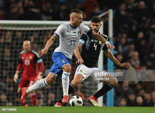 Ciro Immobile of Italy competes for the ball with Federico Fazio of Argentina during the International friendly match between Italy and Argentina at...