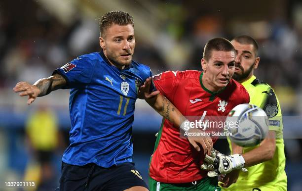 Ciro Immobile of Italy competes for the ball with Valentin Antov of Bulgaria during the 2022 FIFA World Cup Qualifier match between Italy and...