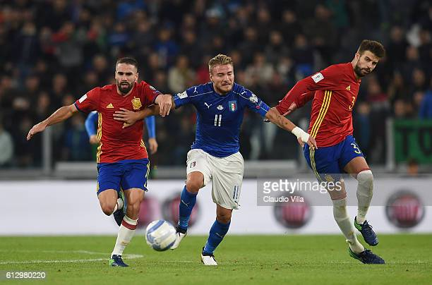 Ciro Immobile of Italy fights for the ball with Dani Carvajal and Gerard Pique of Spain during the FIFA 2018 World Cup Qualifier between Italy and...