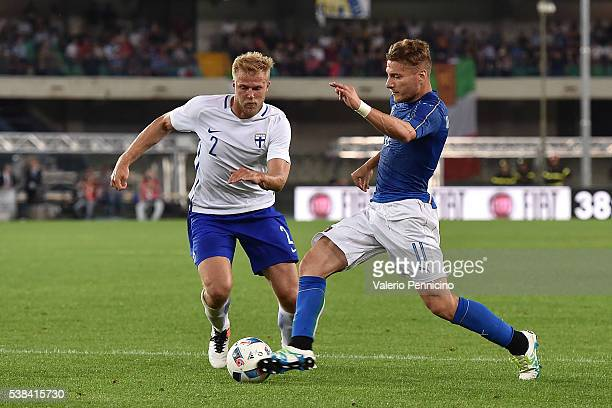Ciro Immobile of Italy in action against Paulus Arajuuri of Finland during the international friendly match between Italy and Finland on June 6 2016...