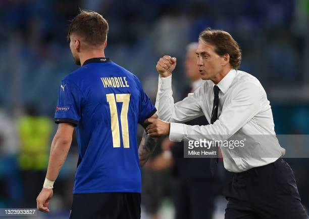 Ciro Immobile of Italy is congratulated by Roberto Mancini, Head Coach of Italy after scoring his teams third gaol during the UEFA Euro 2020...