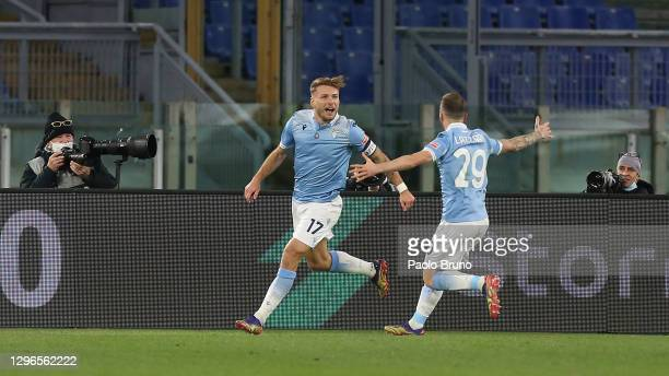 Ciro Immobile of Lazio celebrates with Manuel Lazzari of Lazio after opening the scoring during the Serie A match between SS Lazio and AS Roma at...