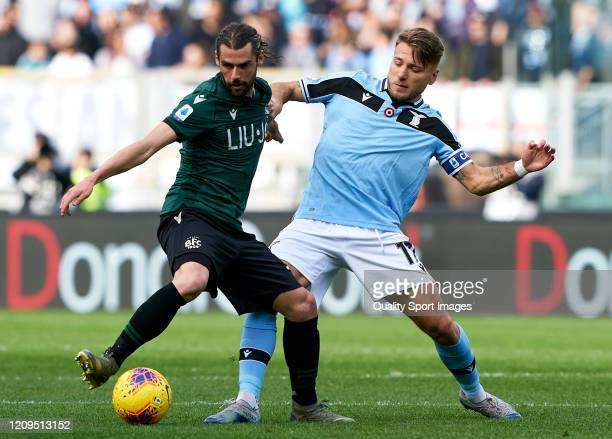 Ciro Immobile of Lazio competes for the ball with Andrea Poli of Bologna during the Serie A match between SS Lazio and Bologna FC at Stadio Olimpico...
