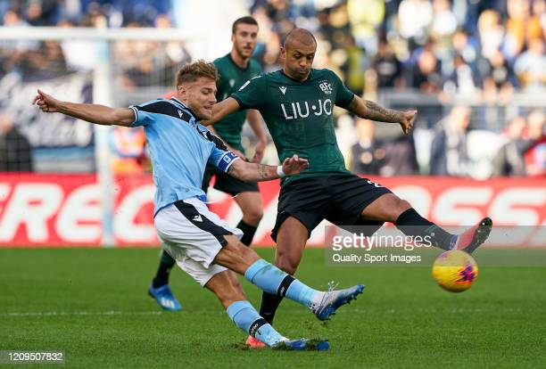 Ciro Immobile of Lazio competes for the ball with Danilo Larangeira of Bologna during the Serie A match between SS Lazio and Bologna FC at Stadio...