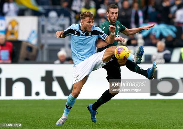 Ciro Immobile of Lazio competes for the ball with Mattia Bani of Bologna during the Serie A match between SS Lazio and Bologna FC at Stadio Olimpico...