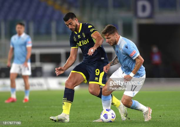 Ciro Immobile of S.S. Lazio battles for possession with Graziano Pelle of Parma Calcio 1913 during the Serie A match between SS Lazio and Parma...