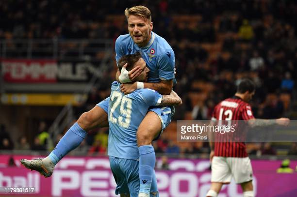Ciro Immobile of SS Lazio celebrate a opening goal with his team mates during the Serie A match between AC Milan and SS Lazio at Stadio Giuseppe...