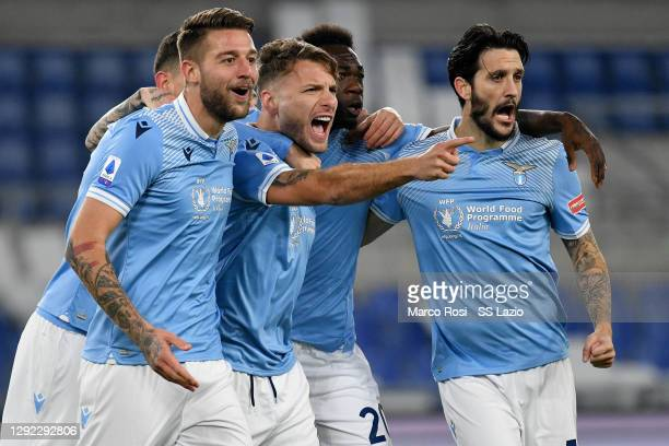 Ciro Immobile of SS Lazio celebrate a opening goal with his team mates during the Serie A match between SS Lazio and SSC Napoli at Stadio Olimpico on...