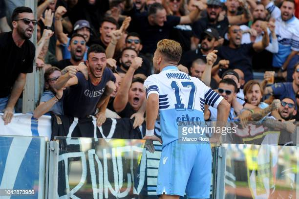 Ciro Immobile of SS Lazio celebrates a frist goal during the Serie A match between AS Roma and SS Lazio at Stadio Olimpico on September 29 2018 in...