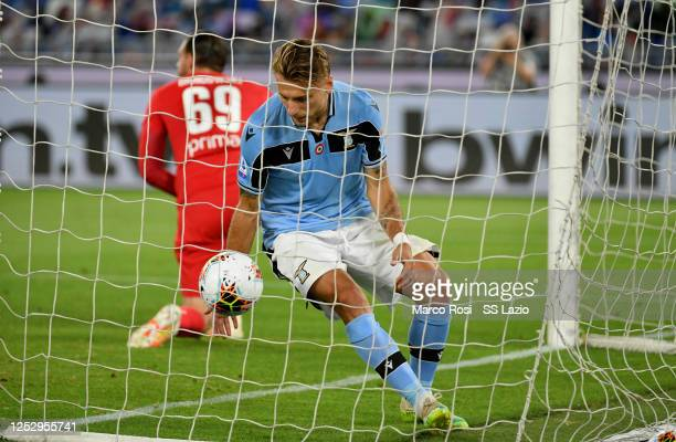 Ciro Immobile of SS Lazio celebrates a frist goal during the Serie A match between SS Lazio and ACF Fiorentina at Stadio Olimpico on June 27 2020 in...