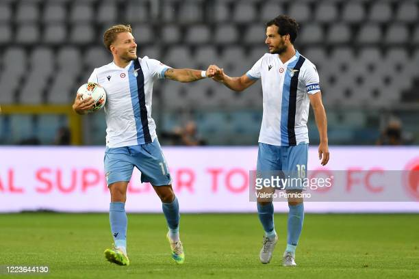 Ciro Immobile of SS Lazio celebrates a goal with team mate Marco Parolo during the Serie A match between Torino FC and SS Lazio at Stadio Olimpico di...