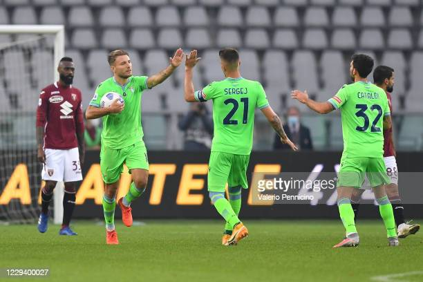 Ciro Immobile of SS Lazio celebrates a goal with team mate Sergej Milinkovic-Savic during the Serie A match between Torino FC and SS Lazio at Stadio...
